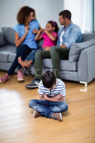 Chateado menino sessão piso Foto stock © wavebreak_media