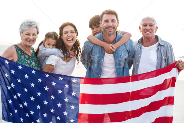 Famille heureuse drapeau américain plage homme heureux enfant Photo stock © wavebreak_media