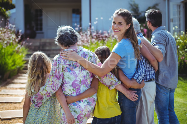 Cheerful woman with family in back yard Stock photo © wavebreak_media