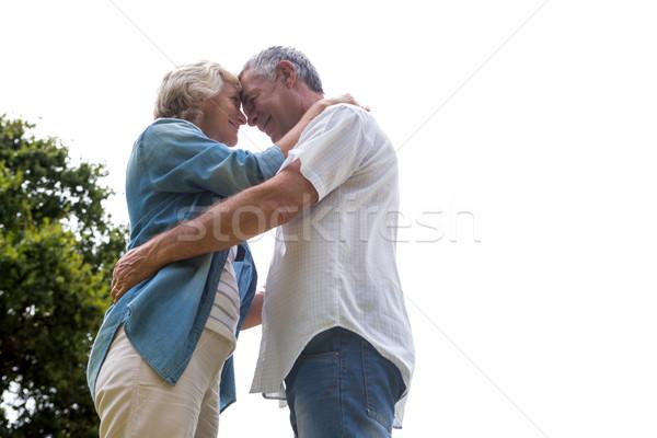 Romantic senior couple embracing against sky Stock photo © wavebreak_media