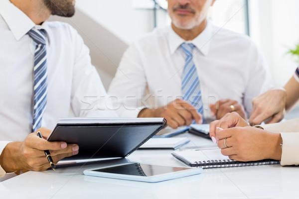 Mid section of businessmen and businesswomen discussing Stock photo © wavebreak_media