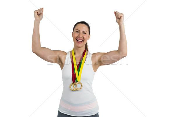 Vrouwelijke atleet poseren gouden medaille overwinning portret Stockfoto © wavebreak_media