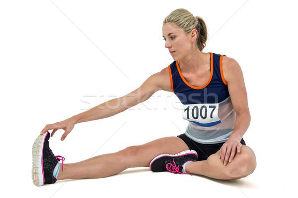 Athletic woman stretching her hamstring Stock photo © wavebreak_media