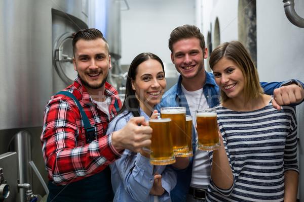 Brewers toasting beers at brewery Stock photo © wavebreak_media