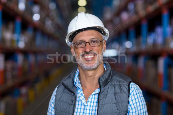 肖像 幸せ ワーカー ポーズ ヘルメット 倉庫 ストックフォト © wavebreak_media