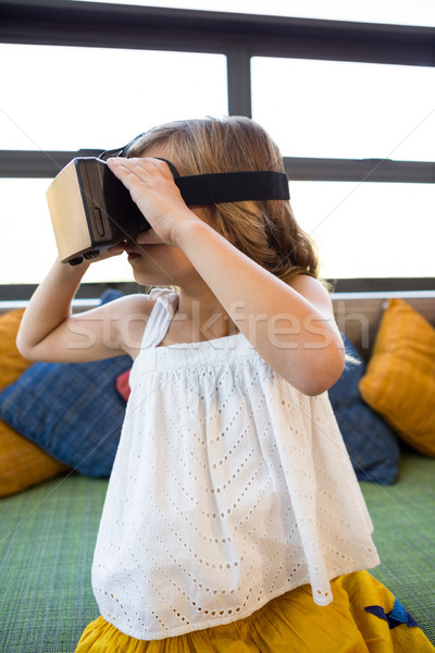 Girl looking through virtual reality in school library Stock photo © wavebreak_media
