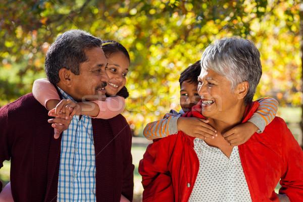 Dziadkowie wnuki parku szczęśliwy człowiek charakter Zdjęcia stock © wavebreak_media