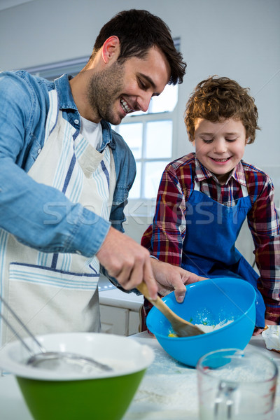 Father teaching his son how to make cup cake Stock photo © wavebreak_media
