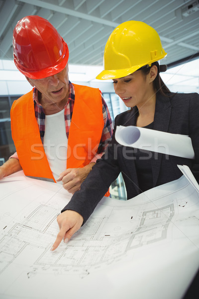 Businesswoman discussing over blueprint with a architect Stock photo © wavebreak_media