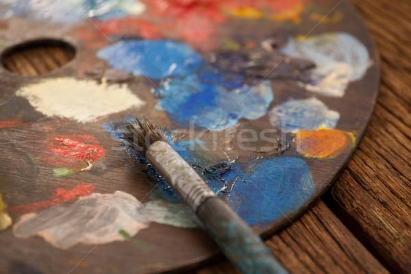Paleta múltiplo cores paint brush madeira educação Foto stock © wavebreak_media