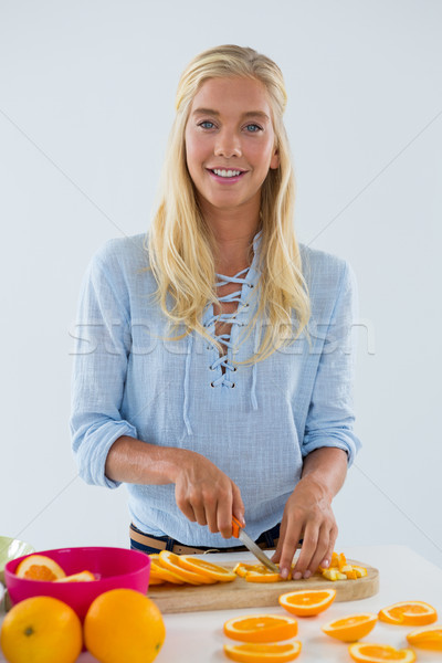 Portrait of woman cutting fruits on chopping board Stock photo © wavebreak_media