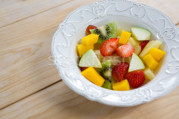 Primer plano picado frutas placa alimentos Foto stock © wavebreak_media