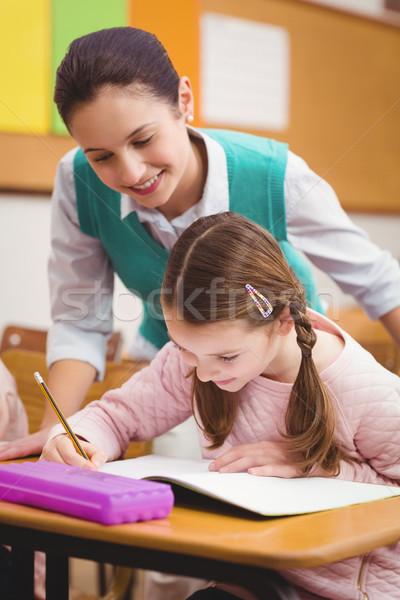 Teacher helping a little girl during class Stock photo © wavebreak_media