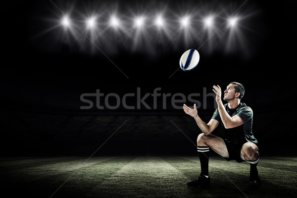 Composite image of full length of rugby player catching the ball Stock photo © wavebreak_media