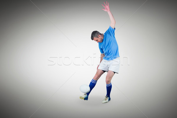 Composite image of rugby player kicking a rugby ball Stock photo © wavebreak_media
