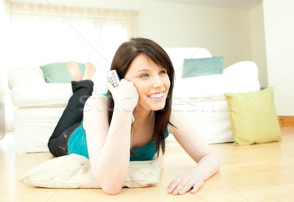Positive woman watching television Stock photo © wavebreak_media