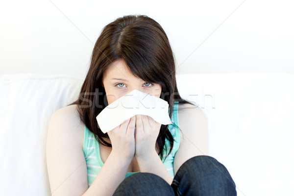 Portrait of a sick attractive woman blowing Stock photo © wavebreak_media