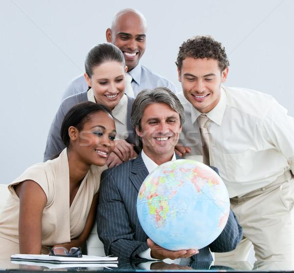 Equipe de negócios globo globalização escritório mulher Foto stock © wavebreak_media