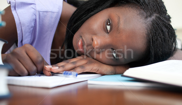 Exhausted teen girl resting while studying Stock photo © wavebreak_media