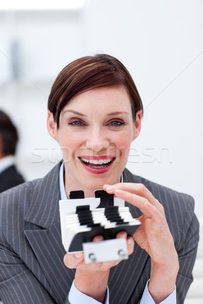Smiling businesswoman holding a card holder Stock photo © wavebreak_media