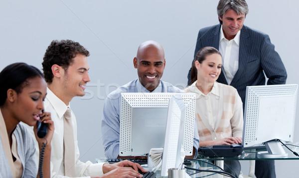Assertive business team working in the office Stock photo © wavebreak_media
