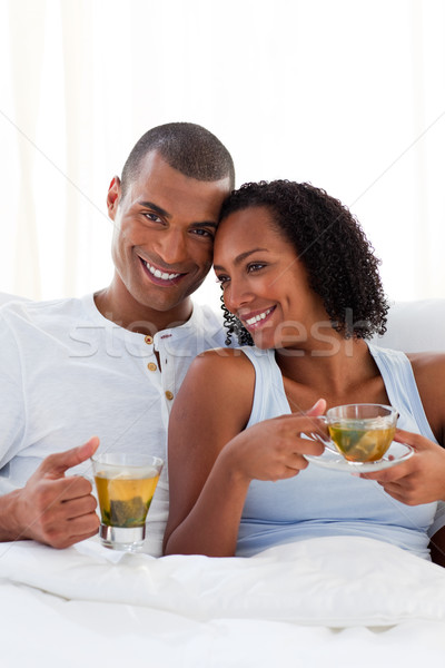 Affectionate couple drinking a cup of tea on their bed Stock photo © wavebreak_media