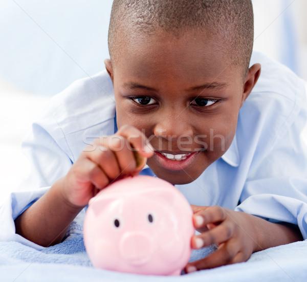 Fiatal srác ágy pénz persely gyermek portré Stock fotó © wavebreak_media