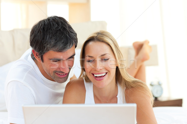 Close-up of lovers using a laptop lying on bed Stock photo © wavebreak_media