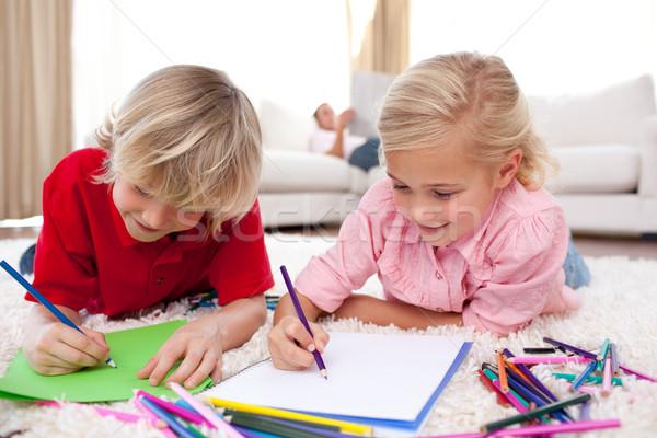 концентрированный детей рисунок полу Жилье улыбка Сток-фото © wavebreak_media