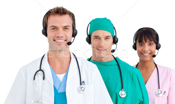 Három orvosok mosolyog fehér telefon férfi Stock fotó © wavebreak_media