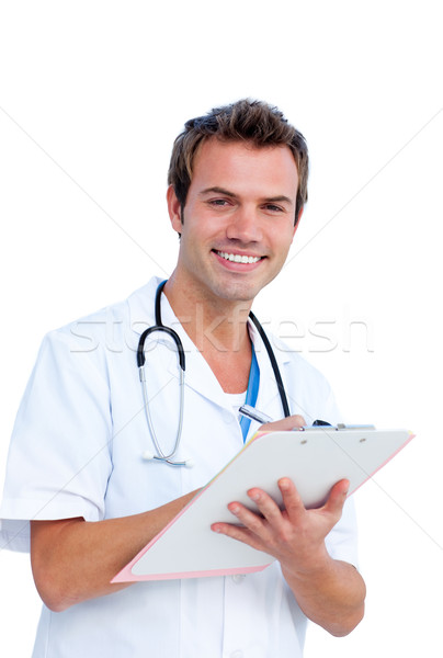 Portrait a charming male doctor writing notes Stock photo © wavebreak_media