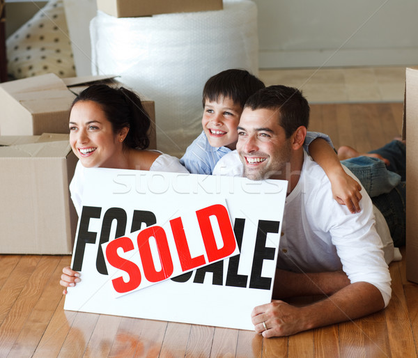 Smiling family on the floor after buying house Stock photo © wavebreak_media