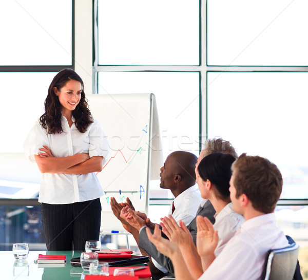 Stock photo: Brunette businesswoman interacting with her colleagues in a pres