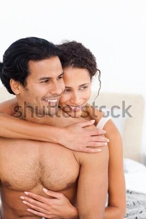 Stock fotó: Romantikus · szerelmespár · átkarol · ágy · otthon · szeretet