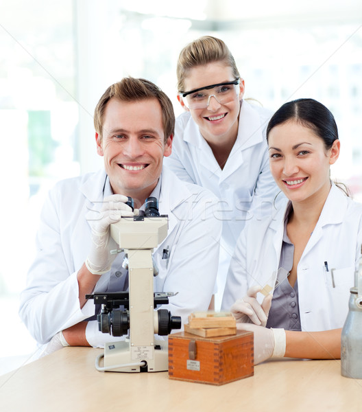 Young scientists working with a microscope Stock photo © wavebreak_media