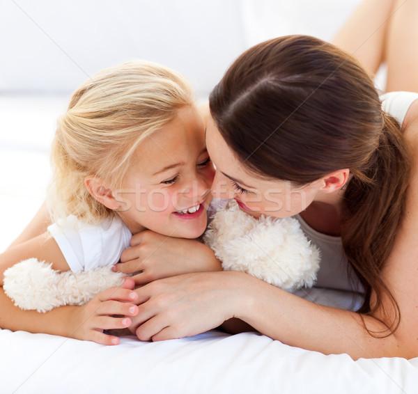 Attentive mother hugging her daughter Stock photo © wavebreak_media