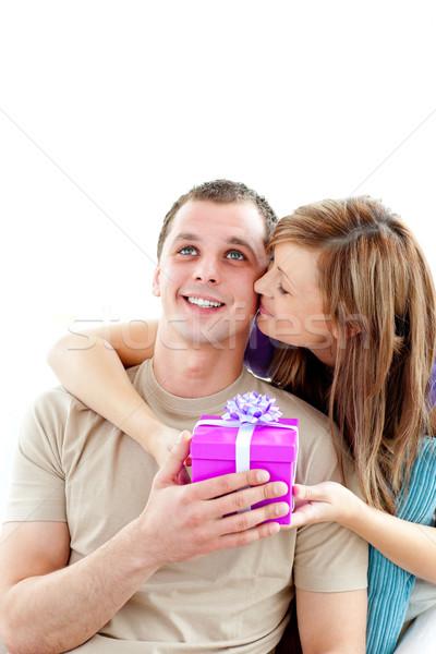 Attractive boyfriend giving a present to his cute girlfriend against white background  Stock photo © wavebreak_media