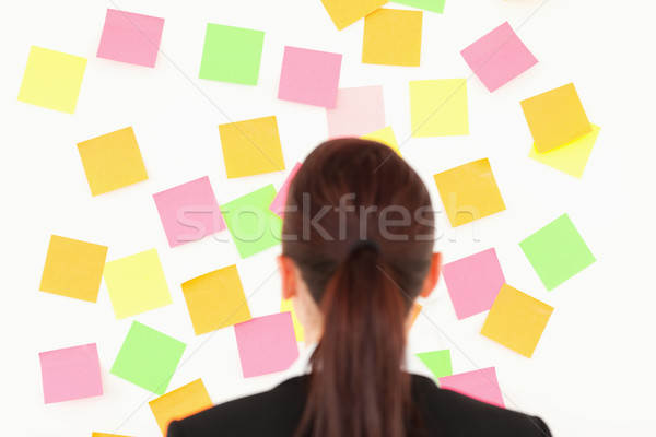 Donna guardando muro completo note bianco Foto d'archivio © wavebreak_media