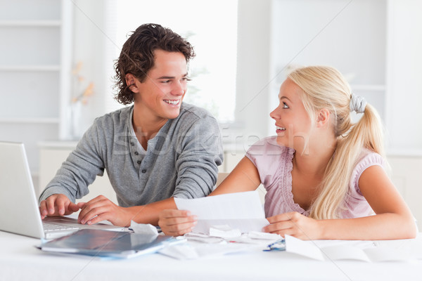 Stock photo: Surprised couple doing their accounts in the living room
