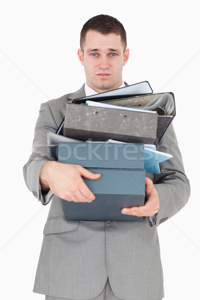 Portrait of a overwhelmed businessman against a white background Stock photo © wavebreak_media