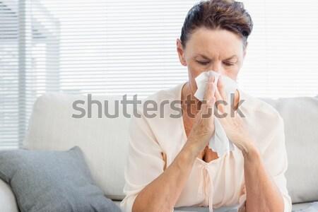 Jonge man blazen neus woonkamer gezondheid sofa ziek Stockfoto © wavebreak_media