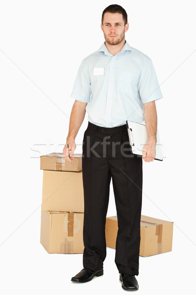 Jovem postar empregado clipboard branco papel Foto stock © wavebreak_media