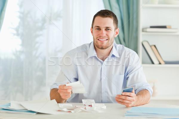 Jovem empresário bolso calculadora papel Foto stock © wavebreak_media