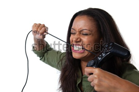 Smiling young woman singing into a microphone against a white background Stock photo © wavebreak_media