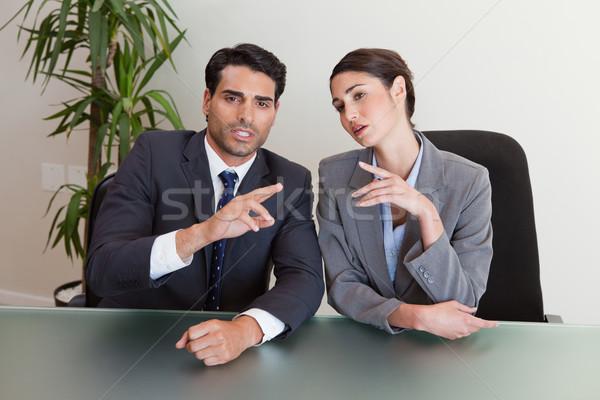 Jól kinéző üzletemberek tárgyal tárgyalóterem megbeszélés üzletember Stock fotó © wavebreak_media