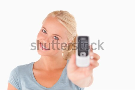 Businesswoman taking a picture of herself against a white background Stock photo © wavebreak_media