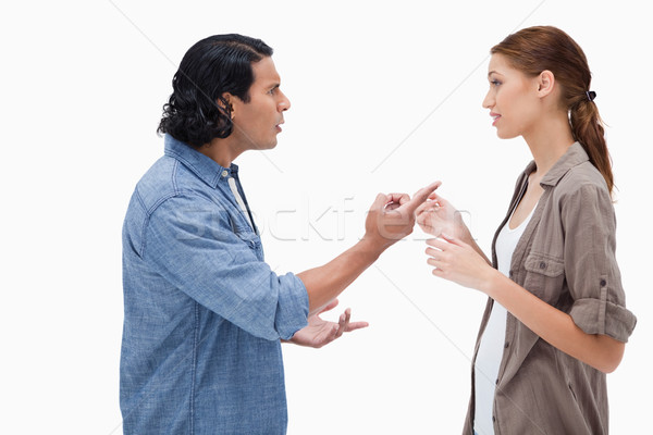 Side view of couple having a serious conversation against a white background Stock photo © wavebreak_media