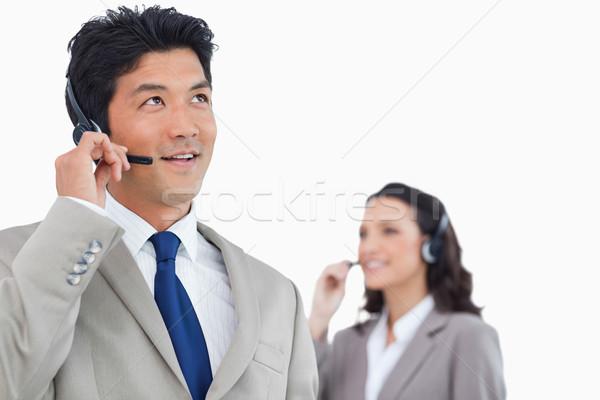 Call center agente fone colega atrás branco Foto stock © wavebreak_media