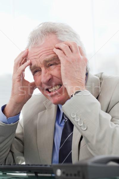 Retrato senior gerente dor de cabeça escritório negócio Foto stock © wavebreak_media