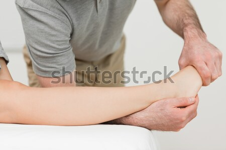 Serious physiotherapist working on an ankle in a room Stock photo © wavebreak_media